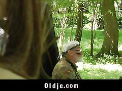 This older elderly is relieving in the woods not being aware that he s on a..
